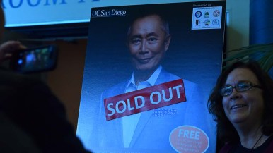 Audience members had their photos taken with a George Takei poster.