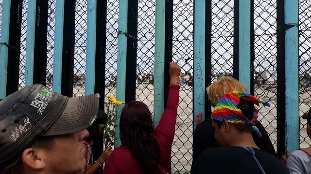 Migrants at border fence