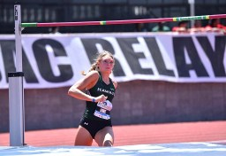 Lily Lowe of Hawaii focuses on bar at Mt. SAC Relays.