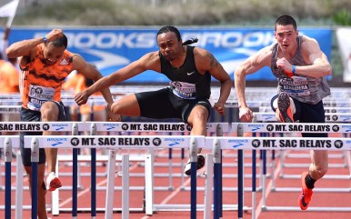 Olympic champion and world record holder Aries Merritt leads Freddie Crittenden III (left) and David Kendziera of lllinois