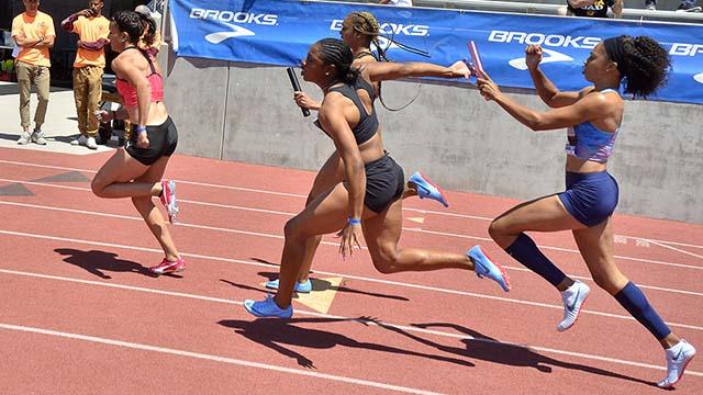 Allyson Felix hands off to Destinee Brown an an All Star 4x100 relay at Mt. SAC Relays.