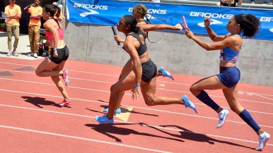 Allyson Felix hands off to Destinee Brown in women's invitational 4x100 at Mt. SAC Relays.
