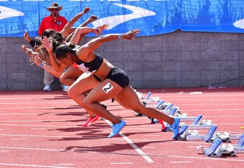 Aaliyah Brown (No. 2) starts in synch with the women's invitational 100-meter dash at the Mt. SAC Relays.