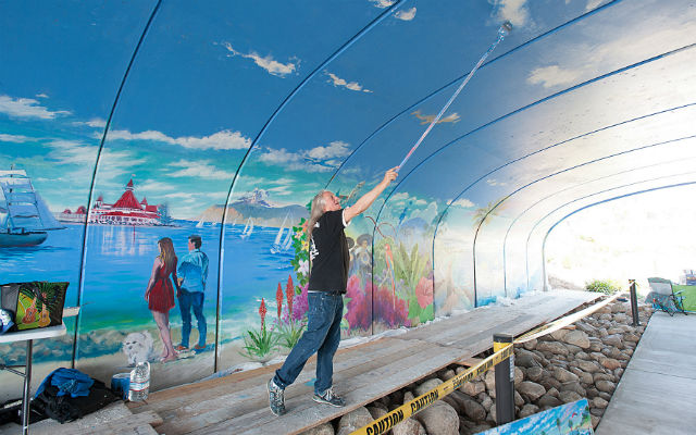 Kevin Anderson works on tunnel mural