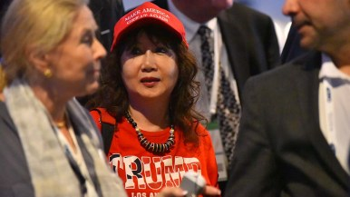 A delegate to the California Republican Party Convention shows her support for President Donald Trump.