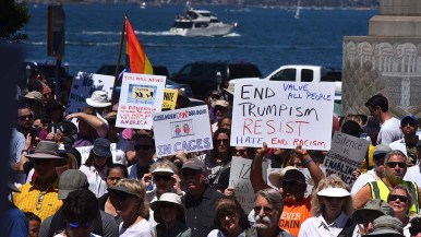 Thousands of people at Waterfront Park show their handmade signs protesting immigration policy.