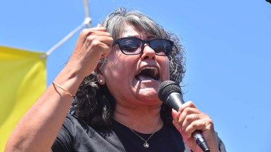 Community activist Gloria Morales-Palos protested the administration's immigration policy.