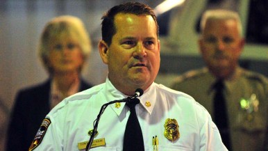 Cal Fire regional Chief Tony Mecham speaks in front of Supervisor Jacob and sheriff's Lt. Emory Wallace.