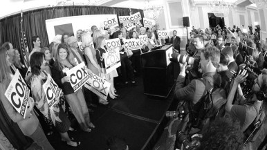 About 40 supporters of governor candidate John Cox squeeze on stage awaiting the Rancho Santa Fe businessman at the U.S. Grant Hotel.