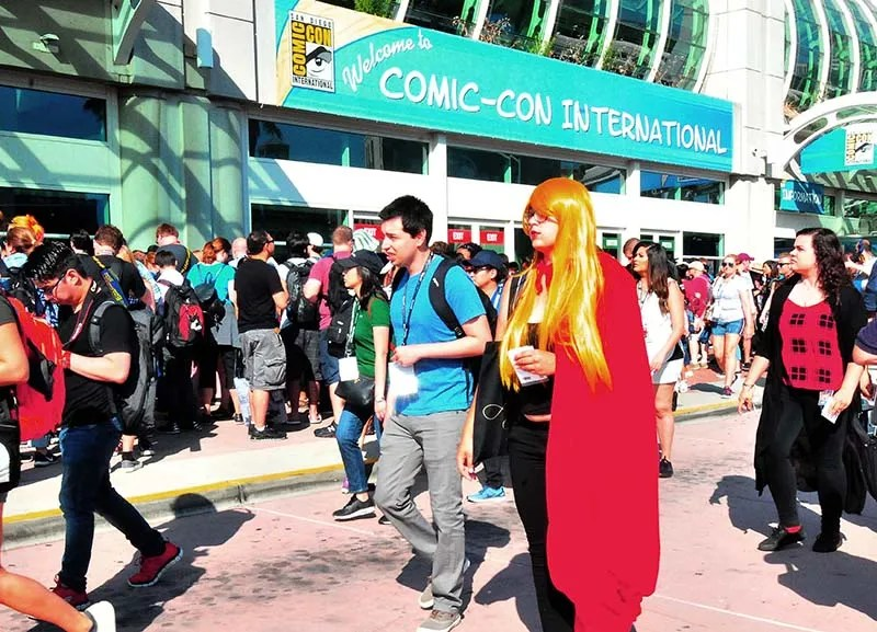 Throngs of people wait outside Comic-Con from the doors to open on the first day.