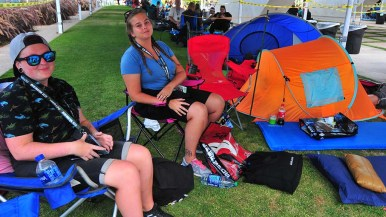Annine Amundsen (left) and Amanda Haukaas, who are camping next to the convention center, are among the first in line for Hall H.