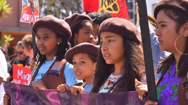 Girls in the Radical Monarch group participate in the march from Chicano Park and the federal building.