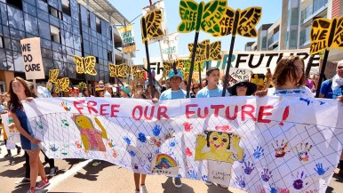 Children lead the Free Our Future march down National Avenue.