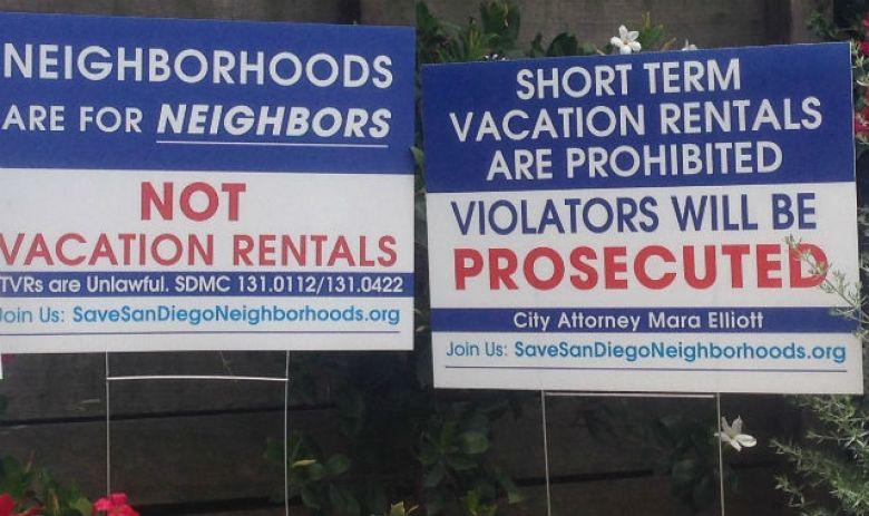 Signs protesting short-term rentals