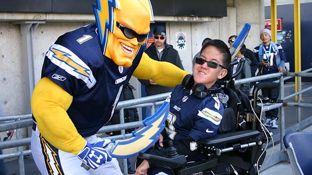 Dan Jauregui as Boltman, shown with young fan, said he regrets not yet being able to share half the proceeds with Rady Children's Hospital.
