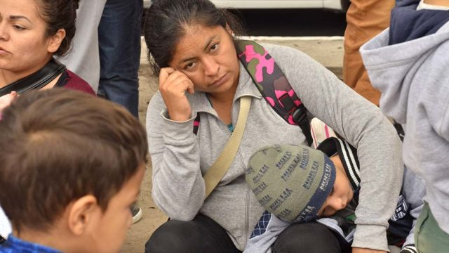 Many women and children from Mexico and Central America wait to see if they would be the next people allowed to enter the U.S