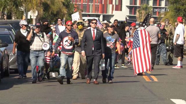 Bordertown Patriots march toward Chicano Park in Barrio Logan on day Frederick Jefferson assaulted Officer Matthew Ruggiero.