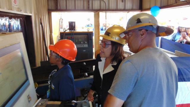 Melinda Odermatt watches as steel is cut