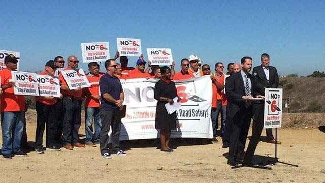 Groups opposing Proposition 6 on November ballot rally in San Diego.