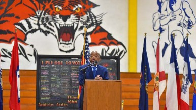 A Morse High School Tiger mascot overlooks Rep. John Lewis during San Diego visit.