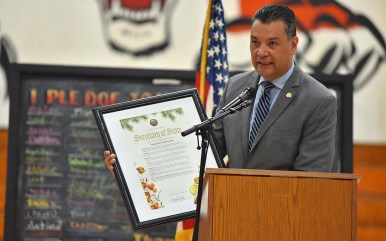 Secretary of State Alex Padilla displays a commendation for Rep. John Lewis.