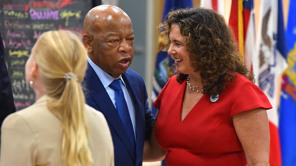 San Diego schools Superintendent Cindy Marten visits with Rep. John Lewis upon his gym arrival.