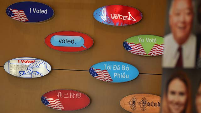 """Wall decorations at San Diego County Registrar of Voters Office evoke """"I voted"""" stickers in different languages."""
