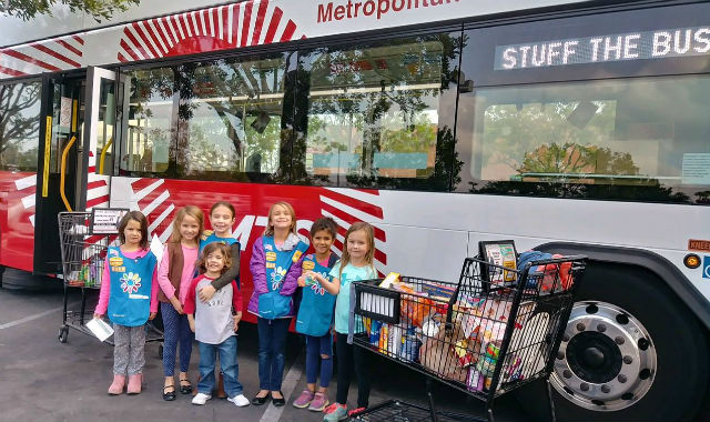 Girl scouts with donated food