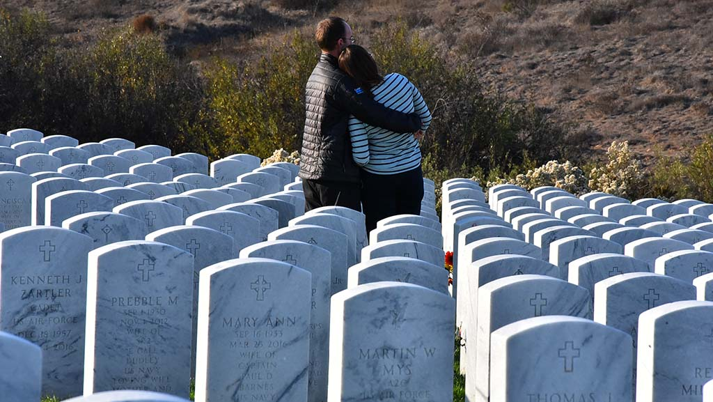 A couple visits Miramar National Cemetery on Veterans Day.
