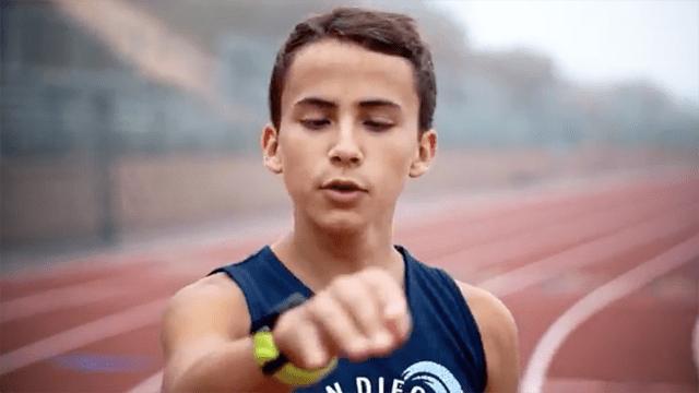 """Joel Gomez, wearing singlet of his former San Diego Waves Track Club, sings """"Running Blind"""" in a YouTube video."""