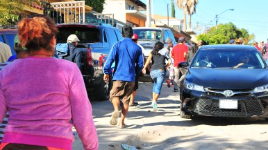 A group of people ran when a volunteer opened his car filled with donations.