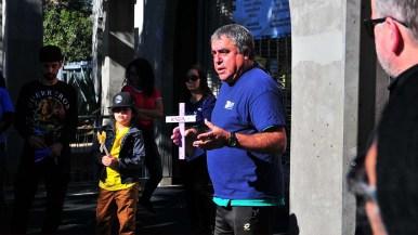 Border Angel director Enrique Morones speaks to volunteers and Border Angel workers before the Caravan of Love.