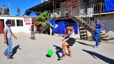 El Barretal shelter residents play soccer in the courtyard at El Barretal shelter.