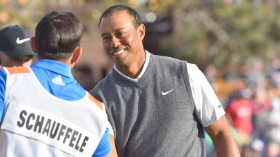 Tiger Woods shakes hands with Xander Schauffele caddie after first round of Farmers Insurance Open.