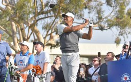 All eyes follow a Tiger Woods drive on Day 1 of Farmers Insurance Open.