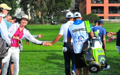 Fans connect with Xander Schauffele of San Diego as he moves around Torrey Pines' South Course.
