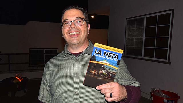 Brent Beltrán shows off the first issue of his full-color monthly magazine promoting Barrio Logan business and culture. It's called La Neta (slang for The Truth): A magazine for the 92113.