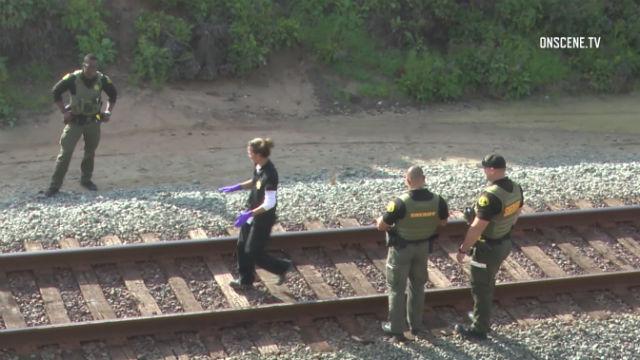 Sheriff's deputies examine track in Del Mar