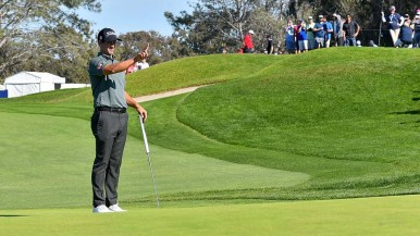 Adam Scott checks the wind of the last day of play at the Farmers Insurance Open in La Jolla.