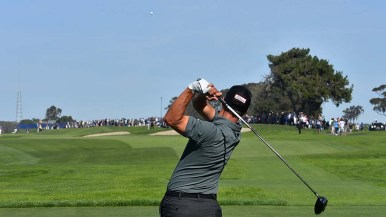 Adam Scott tees off on the 4th hole of the south course at the Farmers Insurance Open in La Jolla.