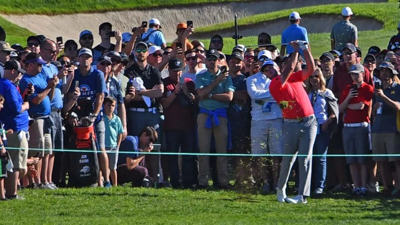 Jon Rahm shoots out of the spectator area on the 18th hole of the Farmers Insurance Open on the Torrey Pines Golf Course.
