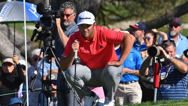 Jon Rahm sizes up the 1st hole on the last day of the Farmers Insurance Open tournament.