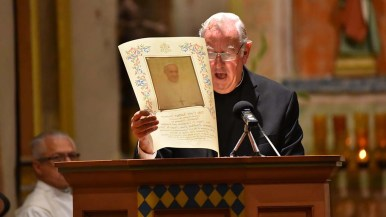 Msgr. Mark Cambell, former pastor of the mission, read a message from Pope Francis.
