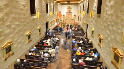 Attendees enter the mission before the prayer service commemorating the 250th anniversary of the church.