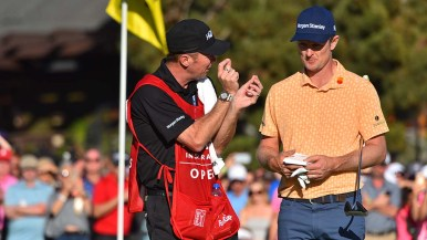 Jason Rose and his caddie strategize about the 18th hole.