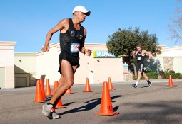 """Men's 50K winner David Velasquez of Ecuador rounds southern end of course near Mission Gorge Road. """"My mother died 10 weeks ago, so this was for her,"""" he said in Spanish."""