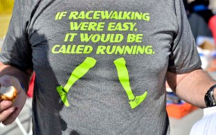 """Tracy Sundlun wears T-shirt from ReShod Walking: """"If racewalking were easy, it would be called running."""""""