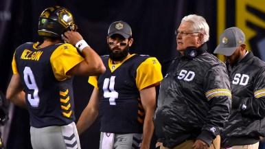 San Diego Fleet Head Coach Mike Martz talks to quarterback Philip Nelson during a timeout.