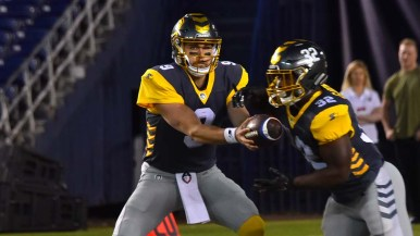 San Diego quarterback Philip Nelson hands off to running back Ja'Quan Gardner.