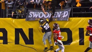 Fleet wide receiver Ja'Quan Gardner high-fives fans after making a 83-yard run for a touchdown.
